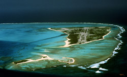Aerial view of Midway Atoll, Spit Island is in the foreground with Eastern Island in the distance