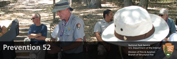 NPS Staff hosting a BBQ in uniform