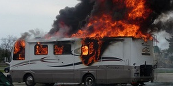 RV engulfed in flames and smoke