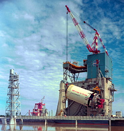 The S-II stage of the Saturn V rocket is hoisted onto the A-2 test stand in 1967 at the Rocket