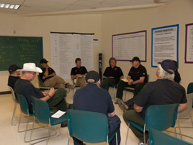 Incident management team members seated in a circle for a meeting