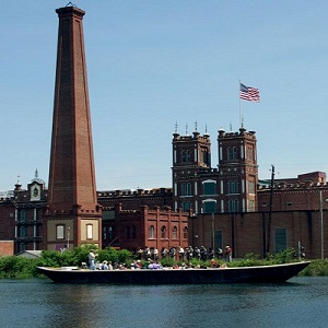 Replica canal boat passes Sibley Mill.