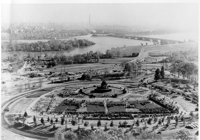 Aerial view shows monument at center and surrounding landscape features