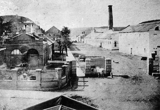 Historic image of buildings lining an unpaved street
