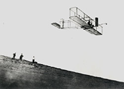 Photograph of Orville Wright in his glider at Kitty Hawk, North Carolina, in 1911.