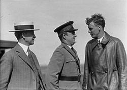 From left to right Orville Wright, Major John F. Curry, and Colonel Charles Lindbergh