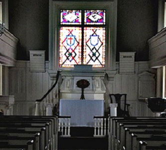 Single stained glass window inside church