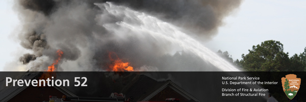 water hose shooting at a burning house