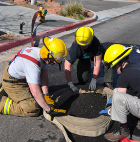 Students practice assembling an attack pack, used for rapid deployment of hose.