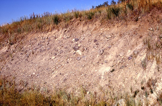 A road cut through a moraine in Yellowstone National Park (WY/MT) exposes the glacial till inside