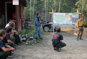The incident commander speaks at a fire briefing