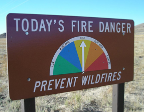 park sign with arrow indication current fire level
