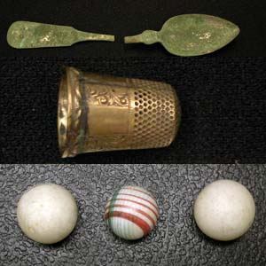 Domestic artifacts like spoons, thimbles, and marbles.