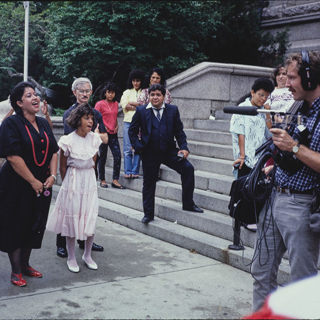 Latinx people singing being recorded as part of the puerto rican festival. Library of Congress