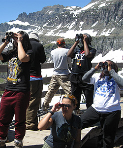 Group of students looking through binoculars