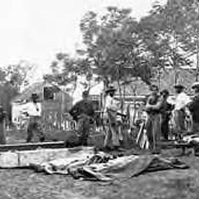 Photo showing burial detail at work following the Siege of Vicksburg