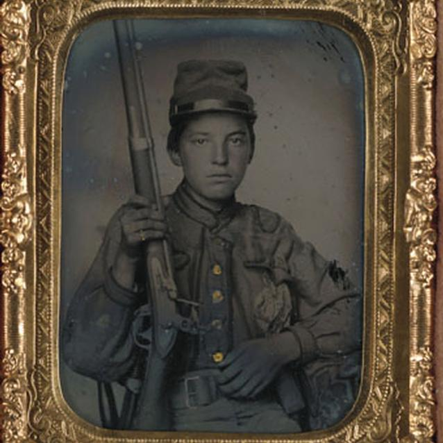 Photograph of a young boy soldier