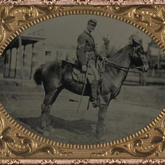 Photograph of a soldier on his horse