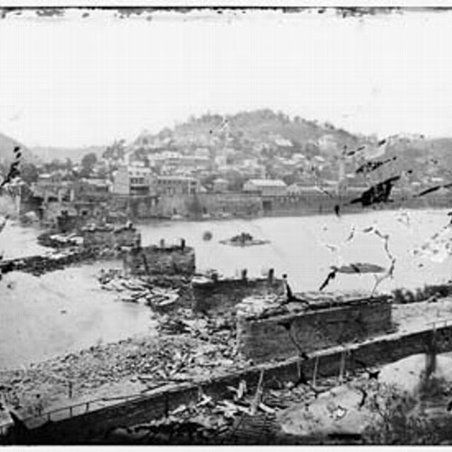 Photograph of the Railroad bridge in ruins at Harpers Ferry in 1862