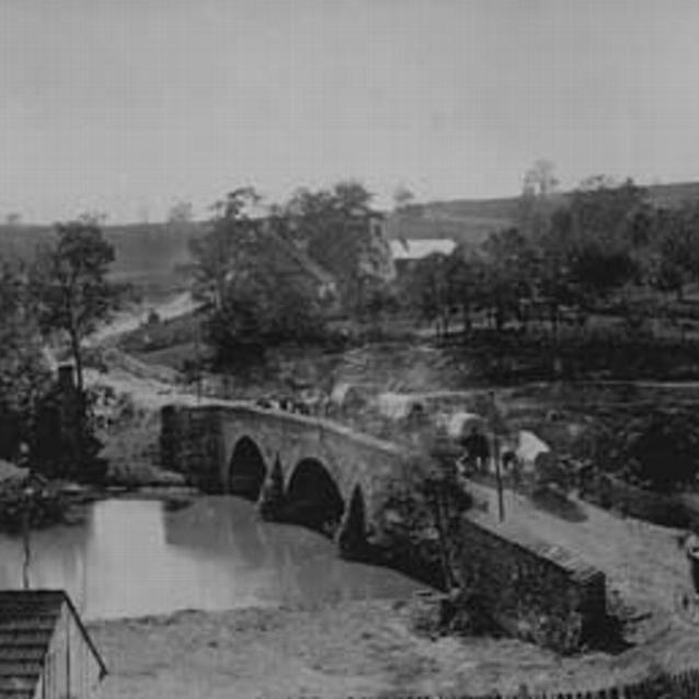 Photograph of Union supply wagons crossing the Middle Bridge over the Antietam Creek after the battle.