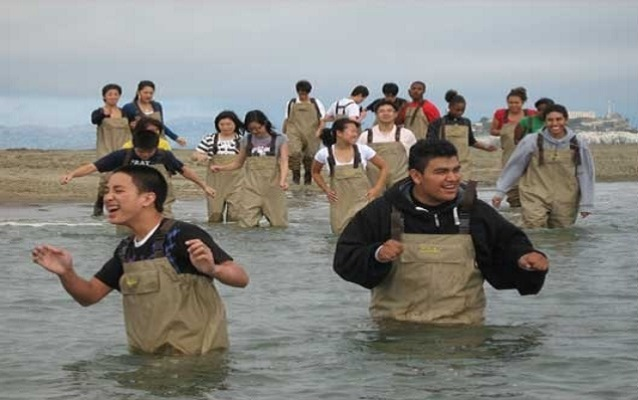 Galileo High School students wade in the water near Crissy Field as part of an AP Environmental Science course.
