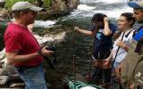 Chris Bowser of NYSDEC instructs summer intern students on building an eel ladder