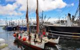 Hokule'a voyaging canoe preparing to dock in New Bedford.