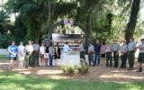 park staff and partners cutting the ribbon on a Fort Caroline entrance sign