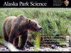 journal cover showing a brown bear in a field