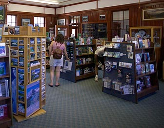 A visitor views merchandise in the Glacier Association Bookstore