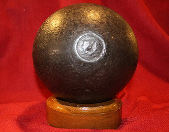 Cannonball on wood stand