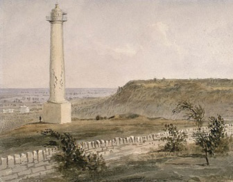 A watercolor painting depicts a tall, white column in a grassy field behind a stone wall.