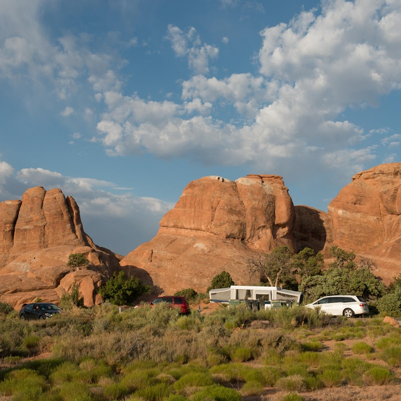 tall, stone formations with cars and trailers beneath them