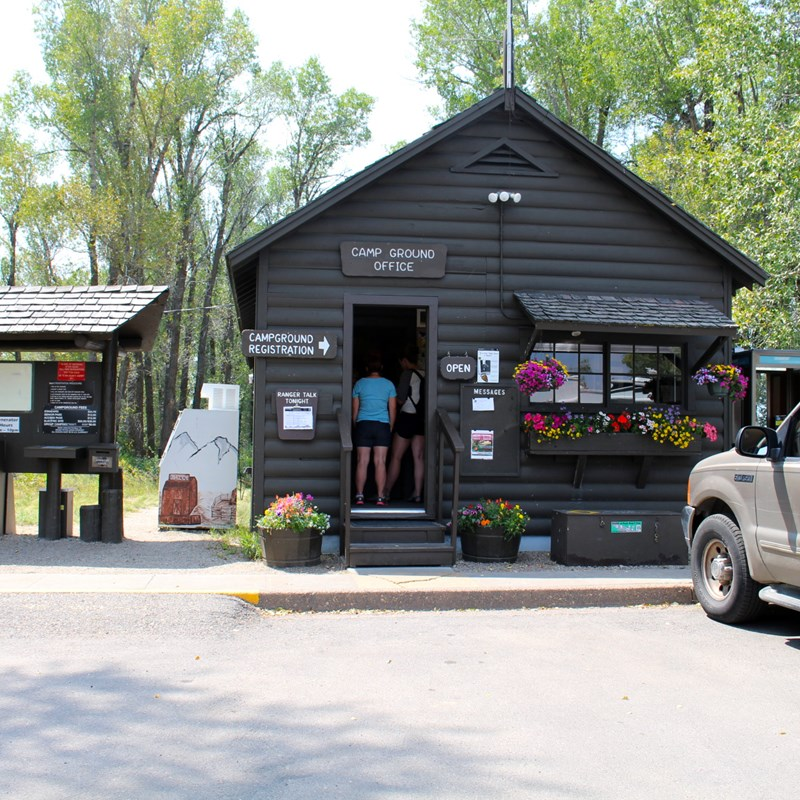 Gros Ventre campground kiosk with information board and visitors checking in.