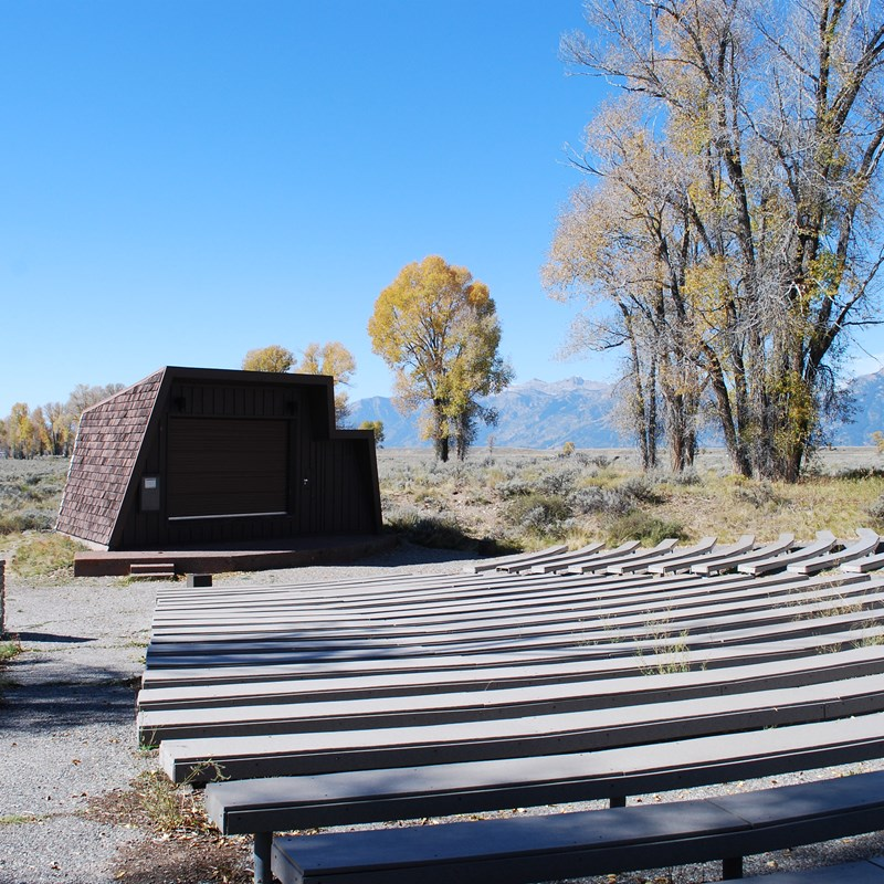 Gros Ventre Campground Amphitheater with bench seats and stage.