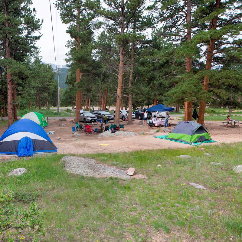 A group site with multiple tents and extra space