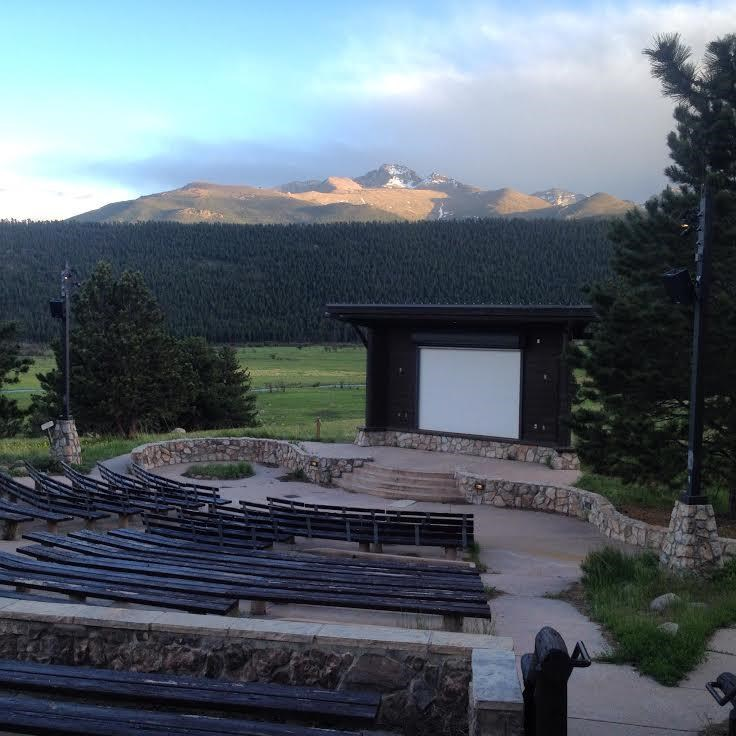Large amphitheater in foreground with snowy mountains behind