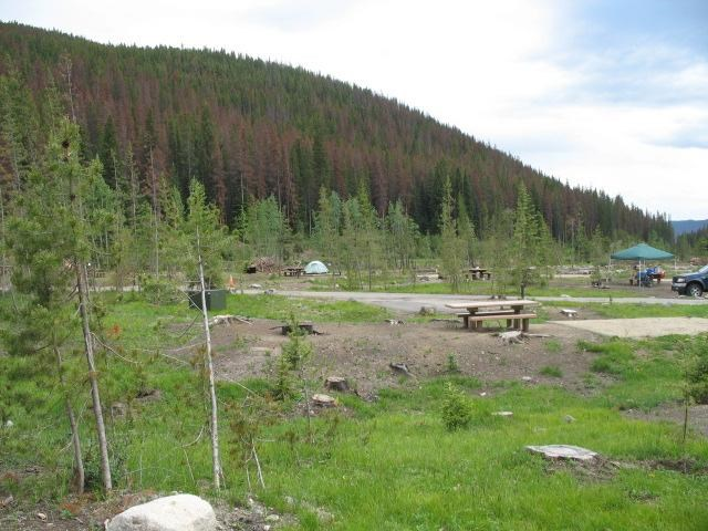 Bare campsites with mountain behind