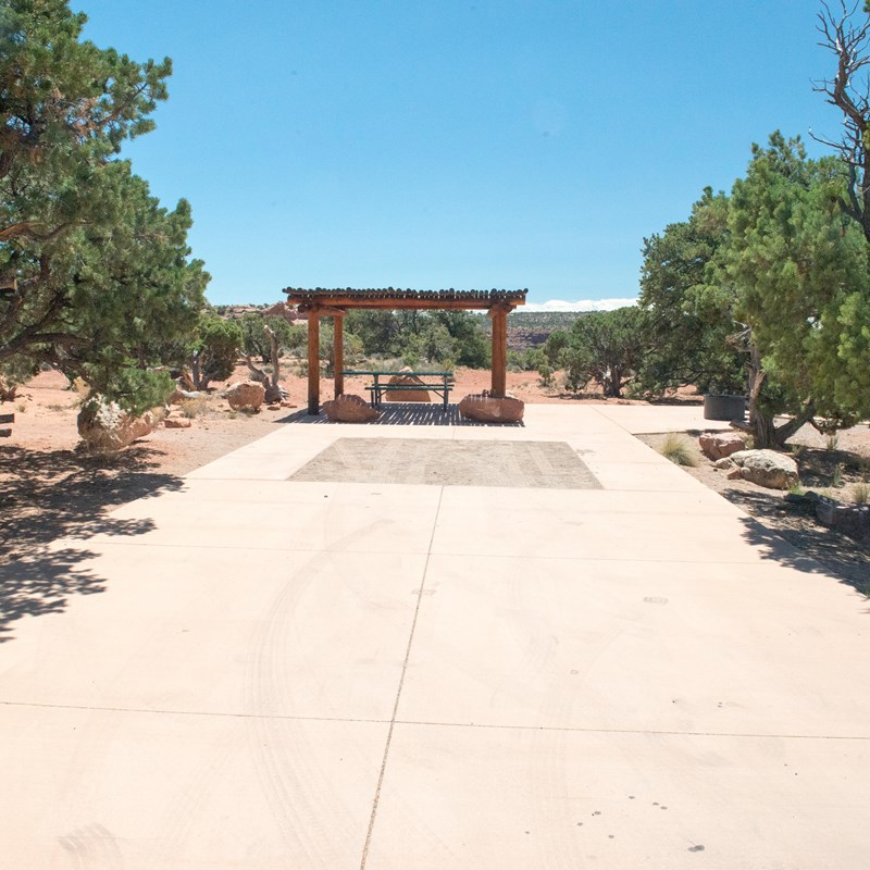 an accessible campsite with paved surfaces surrounding the site