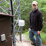 Man standing by monitoring equipment