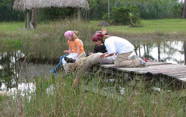 Students doing schoolwork on a dock