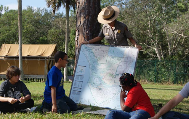 Students study a map of South Florida