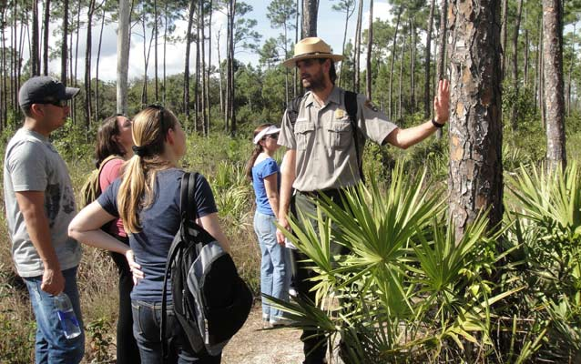 Ranger Nick and adults in the Pine Rockland habitat