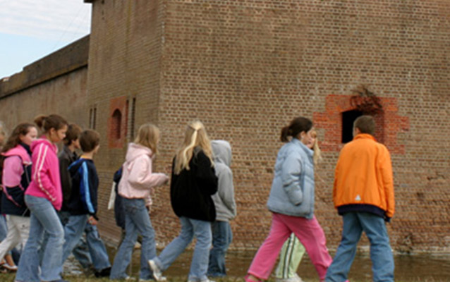 students walking outside fort.