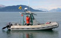 Park Researcher studying Humpback Whales in Glacier Bay.