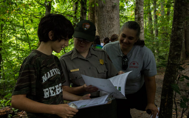 Student working with Ranger to collect data