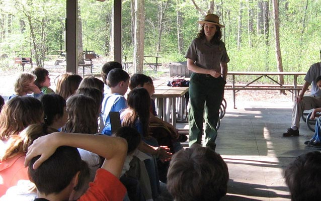 A ranger introduces activities for the day.