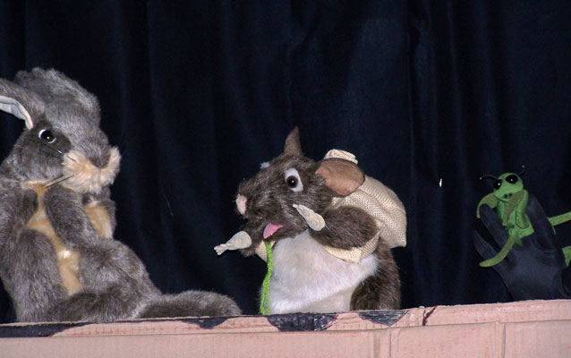 puppet show in progress with rabbit, pack rat, and mantis