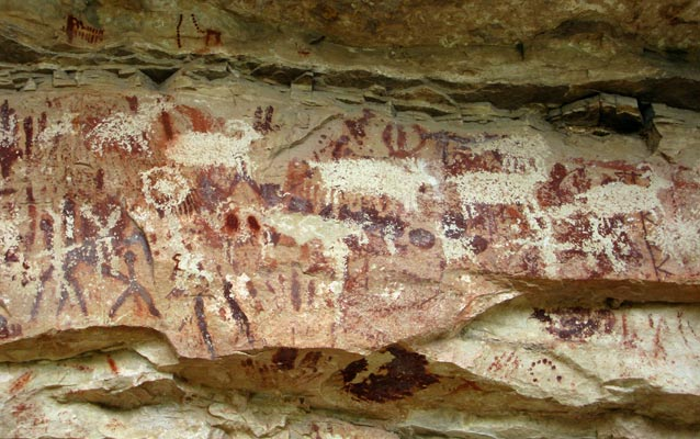 Grand Canyon rock art depicting hunters (left) and game animals.