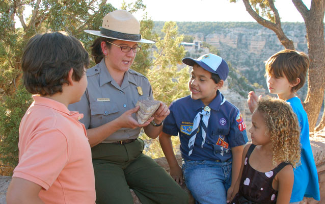 Grand Canyon park ranger teaching students on the rim